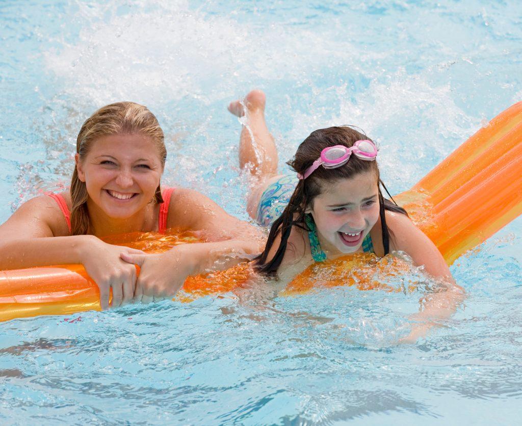 Swimming family having fun
